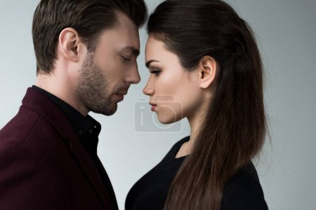 Photo for Beautiful sensual girlfriend and boyfriend togetherness, isolated on grey - Royalty Free Image