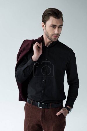 handsome man posing with trendy jacket, isolated on grey