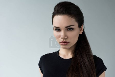 portrait of young beautiful brunette woman, isolated on grey