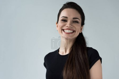 portrait of young smiling woman, isolated on grey