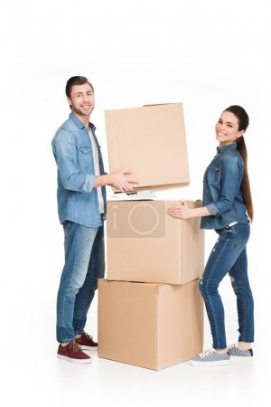 Photo for Happy young couple moving with cardboard boxes, isolated on white - Royalty Free Image