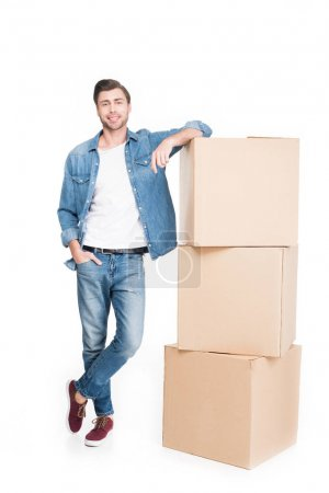 Photo for Smiling young man with carton boxes, isolated on white - Royalty Free Image
