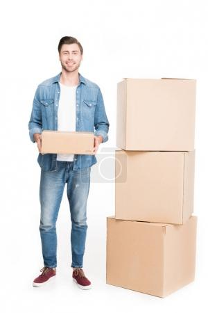 Photo for Happy young man with cardboard boxes, isolated on white - Royalty Free Image
