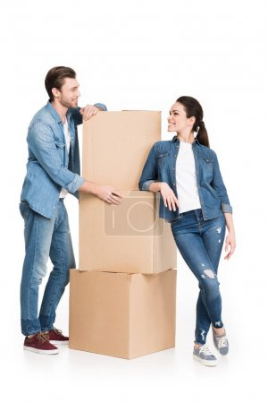 young moving couple with cardboard boxes, isolated on white