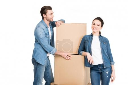moving couple with carton boxes, isolated on white