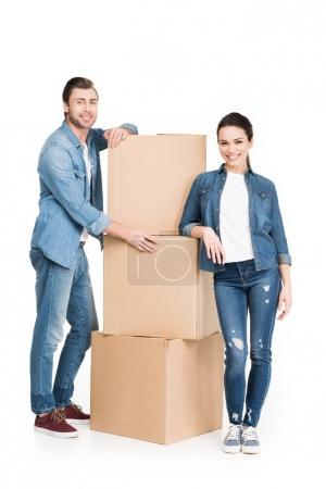 Photo for Young couple with cardboard moving boxes, isolated on white - Royalty Free Image