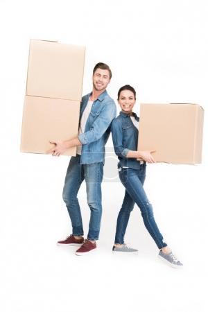 smiling couple holding cardboard boxes, isolated on white