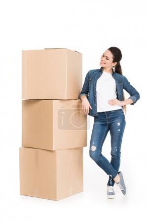 young woman moving with carton boxes, isolated on white