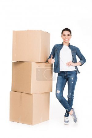 woman with cardboard boxes showing thumb up, isolated on white