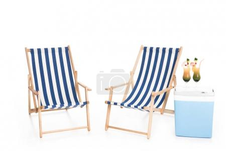 beach chairs, cooler box and summer cocktails, isolated on white