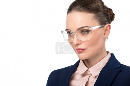 close-up portrait of adult businesswoman in stylish eyeglasses looking away isolated on white