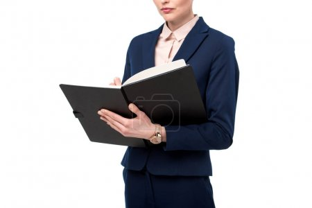 cropped shot of businesswoman writing in notebook isolated on white