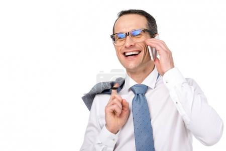 handsome adult businessman talking by phone and laughing isolated on white