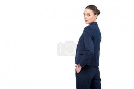 stylish adult businesswoman turning back and looking at camera isolated on white