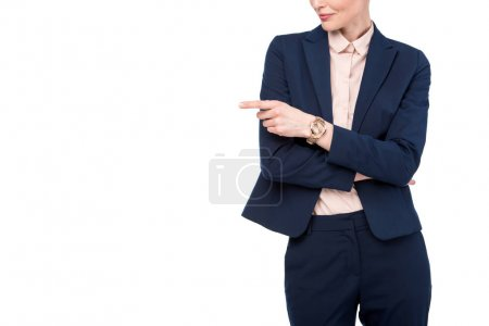 cropped shot of businesswoman pointing on side isolated on white