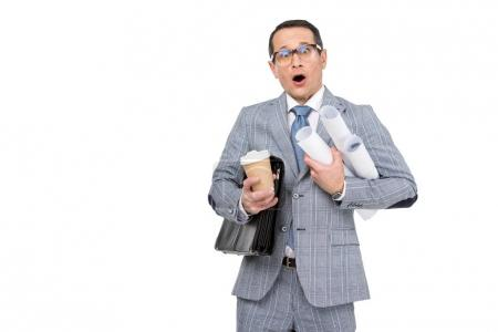 Photo for Shocked overworked businessman with rolls of paperwork and coffee isolated on white - Royalty Free Image