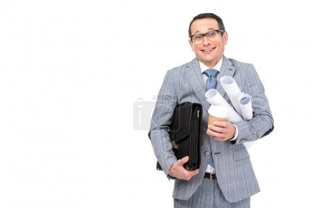 smiling overworked businessman with rolls of paperwork and coffee isolated on white