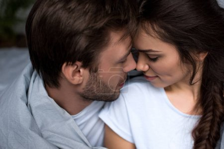 Photo for Young attractive couple hugging in bedroom - Royalty Free Image