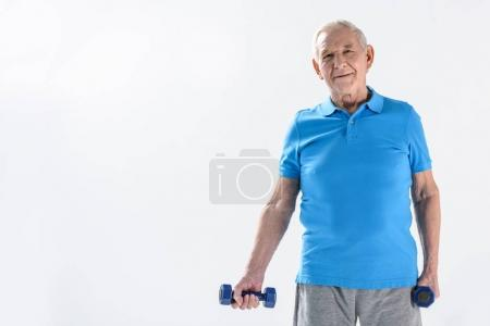 portrait of smiling senior man with dumbbells isolated on grey