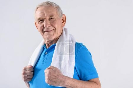 Photo for Portrait of smiling senior man with towel looking at camera isolated on grey - Royalty Free Image