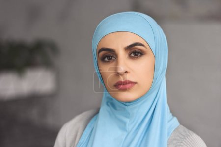 Photo for Portrait of beautiful muslim woman in hijab looking at camera at home - Royalty Free Image