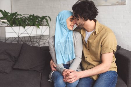 tender muslim couple hugging at home