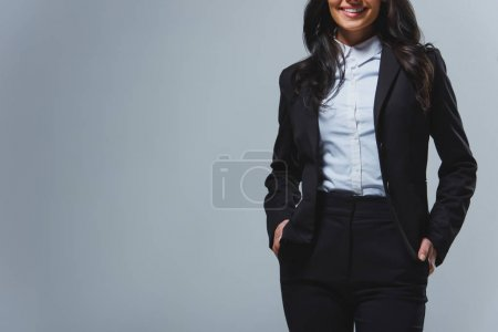 Photo for Cropped image of smiling businesswoman isolated on grey - Royalty Free Image