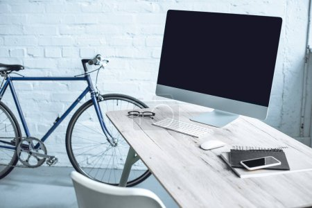 modern workplace with desktop computer and electronics on table