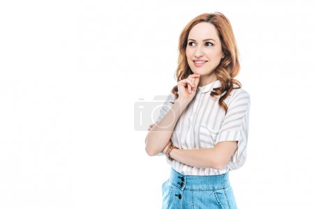 portrait of beautiful smiling woman standing with hand on chin and looking away isolated on white