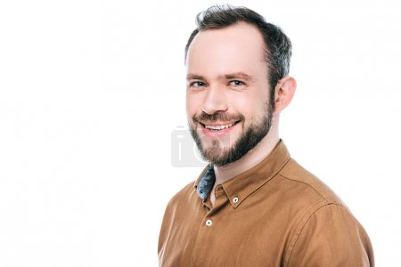 portrait of happy bearded man smiling at camera isolated on white