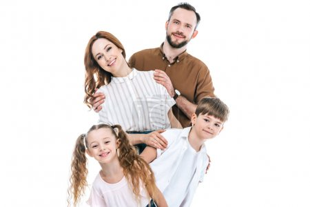 Photo for Cheerful family with two children standing together and smiling at camera isolated on white - Royalty Free Image