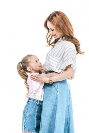 side view of beautiful happy mother and daughter hugging and smiling each other isolated on white
