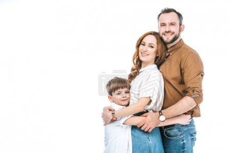 happy parents with adorable little son hugging and smiling at camera isolated on white