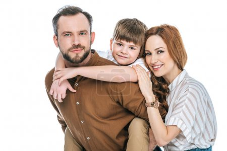 happy parents with adorable little son smiling at camera isolated on white