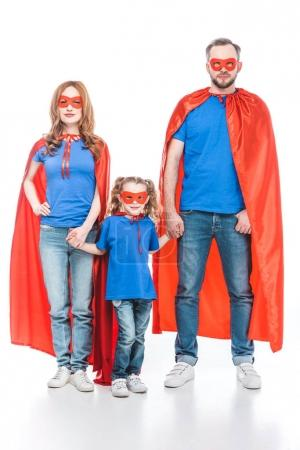Photo for Family of superheroes holding hands and looking at camera isolated on white - Royalty Free Image
