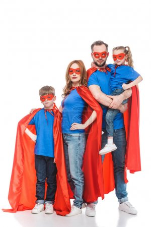 super family in masks and cloaks standing together and looking at camera isolated on white