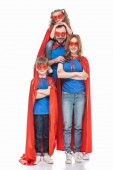 cheerful super family in masks and cloaks smiling at camera isolated on white