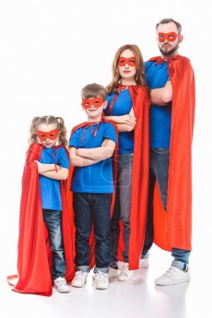Photo for Super family in masks and cloaks standing with crossed arms and looking at camera isolated on white - Royalty Free Image