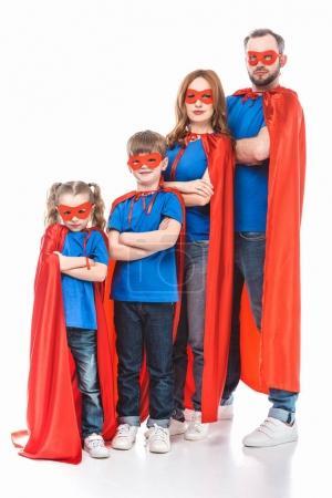 Foto de Super familia de máscaras y capas de pie con los brazos cruzados y mirando a cámara aislada en blanco - Imagen libre de derechos