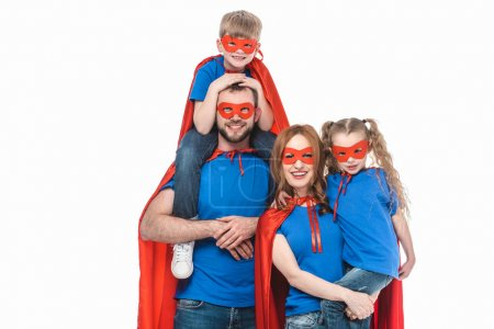 Photo for Cheerful family of superheroes smiling at camera isolated on white - Royalty Free Image