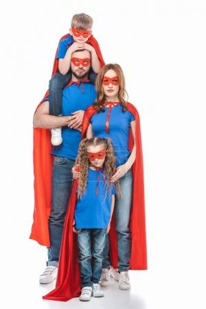 Photo for Full length view of family of superheroes looking at camera isolated on white - Royalty Free Image