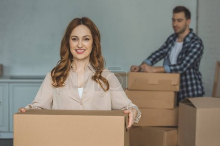 Photo for Selective focus of young couple with cardboard boxes at new home, moving house concept - Royalty Free Image