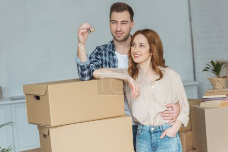 Photo for Portrait of smiling couple looking at keys from new apartment, relocation concept - Royalty Free Image