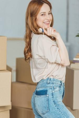 Photo for Smiling woman with keys from new apartment in hand, relocation concept - Royalty Free Image