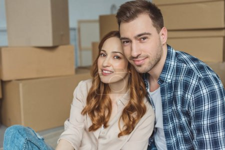 Photo for Portrait of young couple at new apartment with cardboard boxes, relocation concept - Royalty Free Image