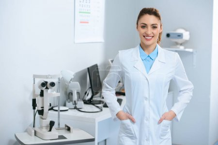 smiling female optometrist posing in optical clinic