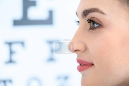 profile of beautiful woman with eye test in optics