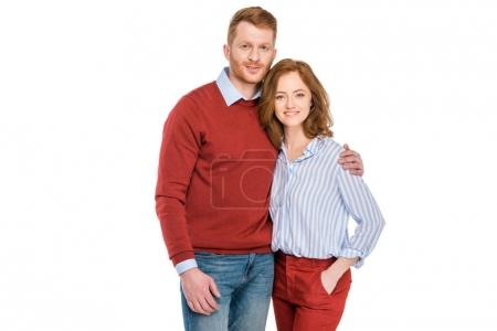 portrait of happy redhead couple standing together and smiling at camera isolated on white
