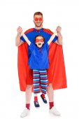 happy father and daughter in superhero costumes having fun together and smiling at camera isolated on white