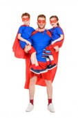 super father carrying happy kids in masks and cloaks isolated on white